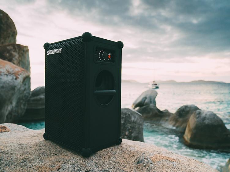 SOUNDBOKS speaker on a rock by the ocean