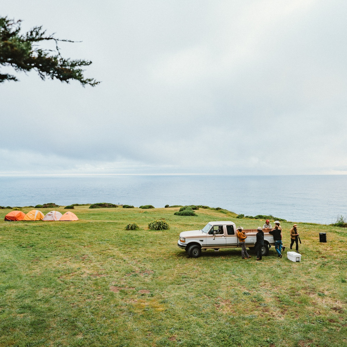 Camping in a vast field with a truck and a SOUNDBOKS