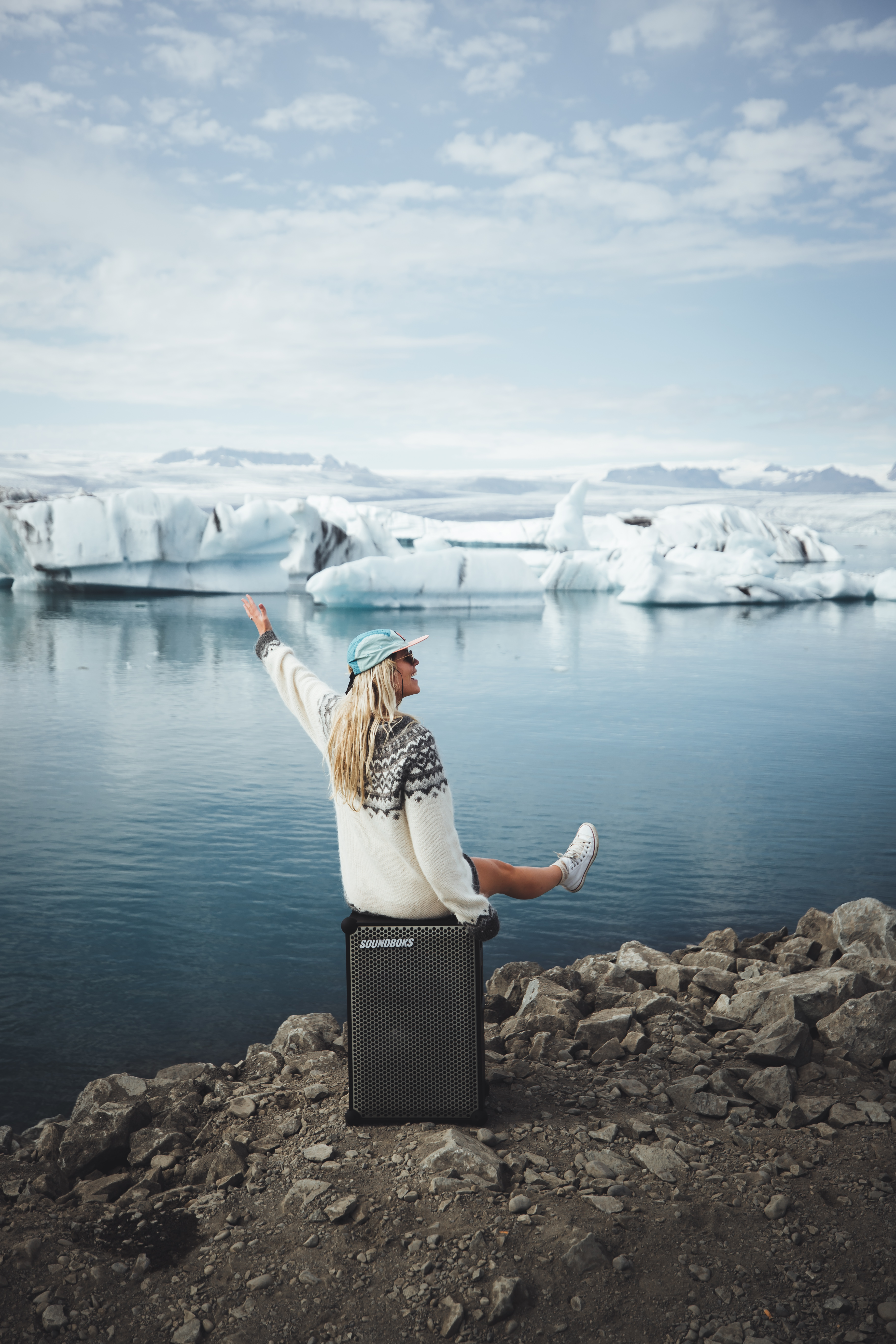Asa sitting on a SOUNDBOKS in front of an iceburg