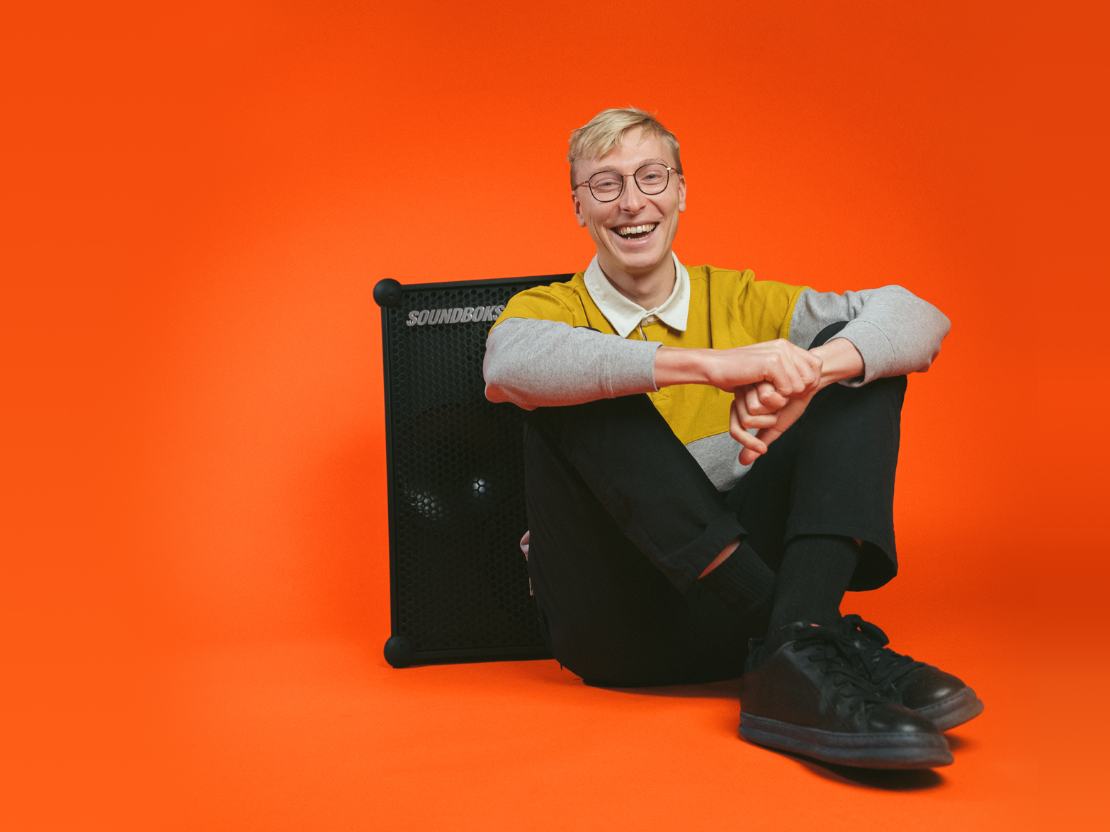 Jesper, SOUNDBOKS CEO in front of an orange background