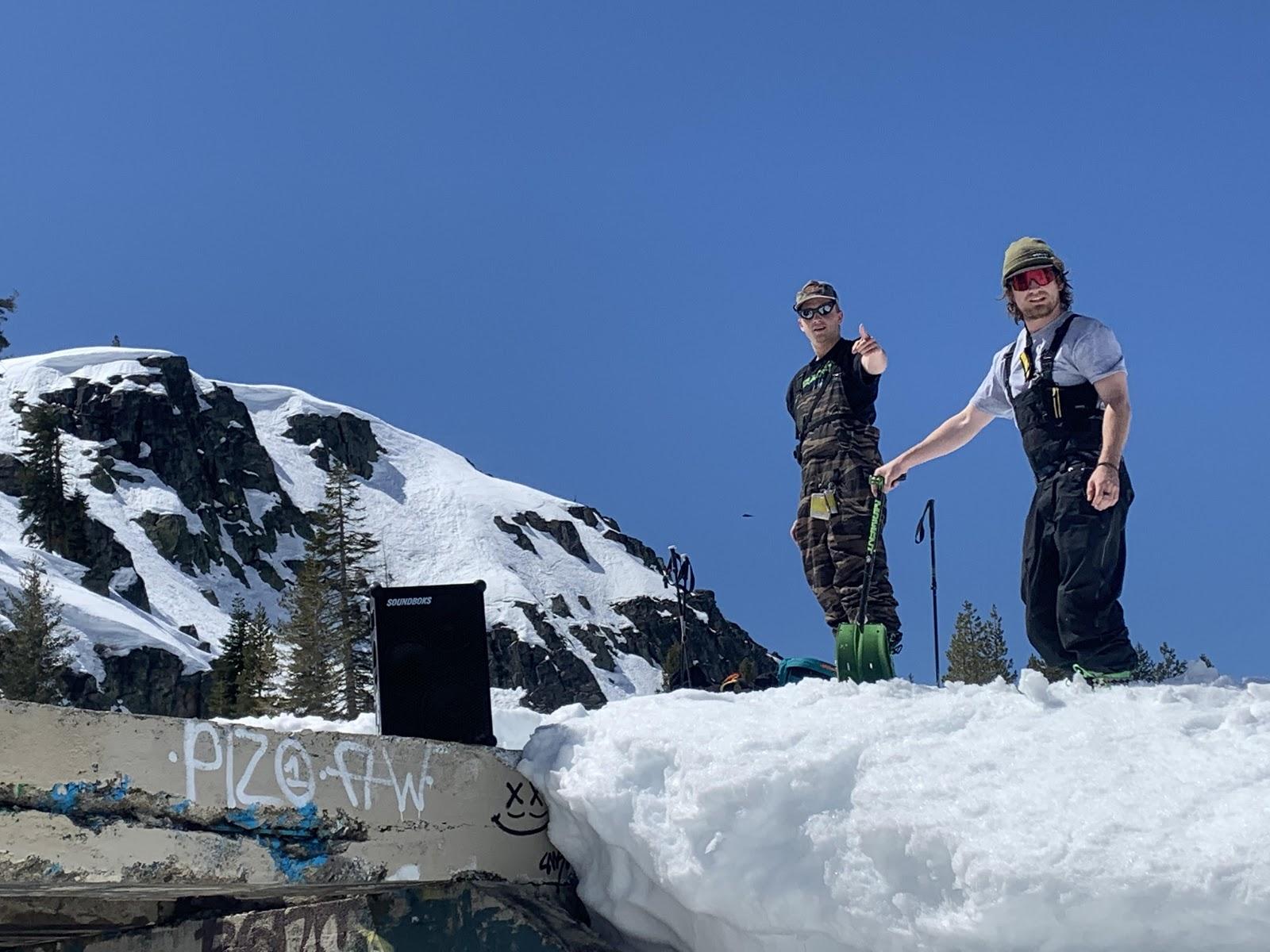 Two guys skiing with a SOUNDBOKS
