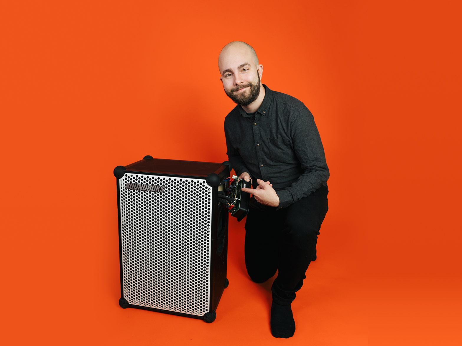 David, SOUNDBOKS developer in front of an orange background