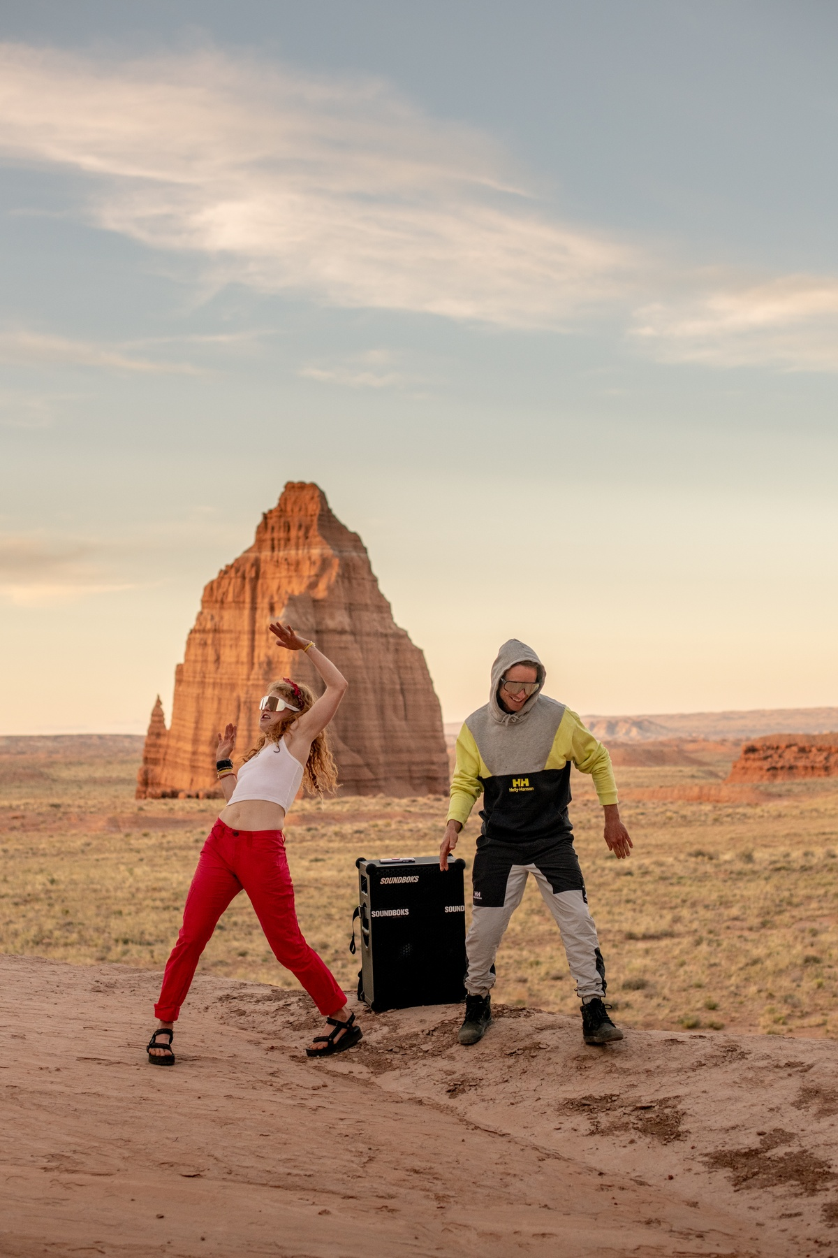girl and guy dancing to a SOUNDBOKS in the desert