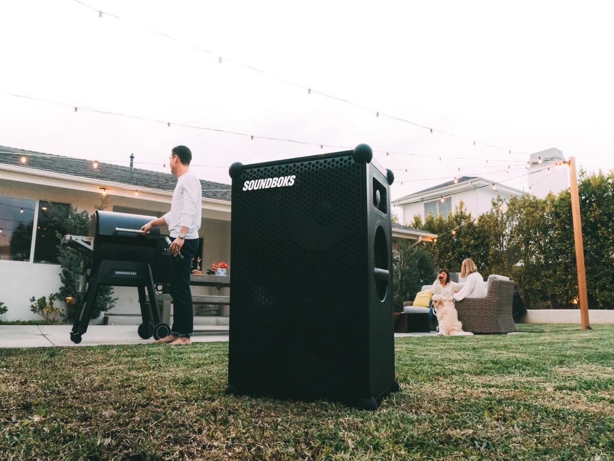 SOUNDBOKS Bluetooth Speaker in a backyard