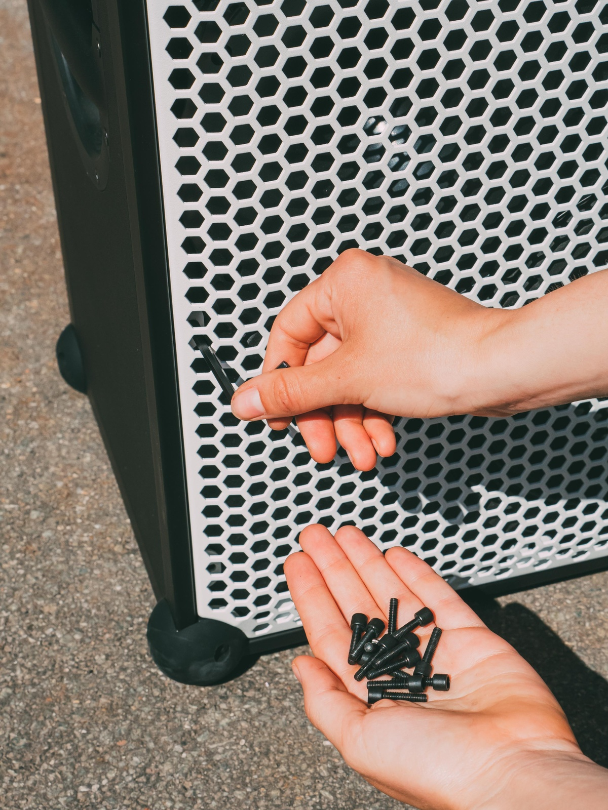 unscrewing the grill off of the SOUNDBOKS Bluetooth Speaker