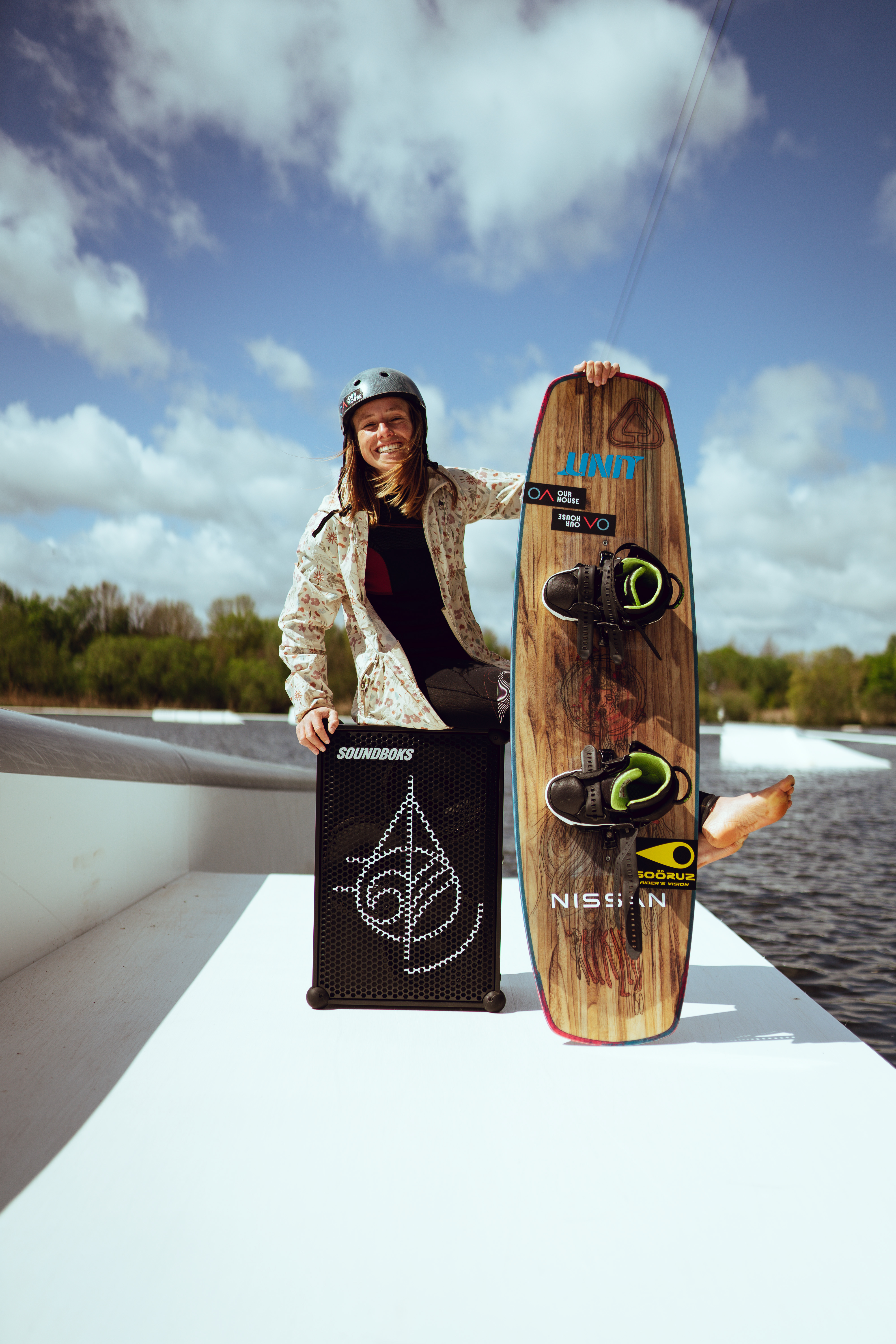 Anna with her SOUNDBOKS and her wakeboard.