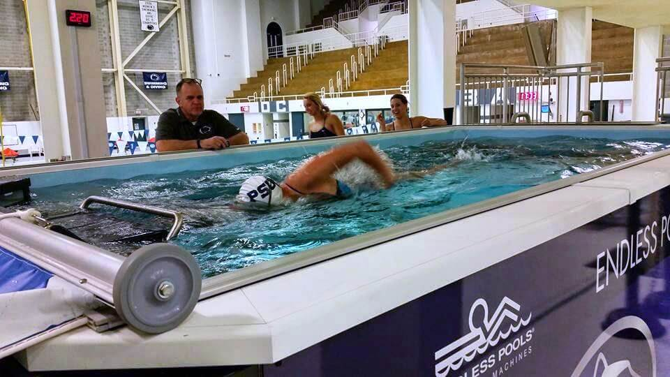 Swimming coach Tim Murphy training a swimmer in the Elite Endless Pool at Penn State