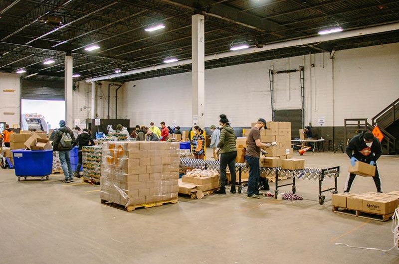 Philadbundance volunteers box food for families in need.
