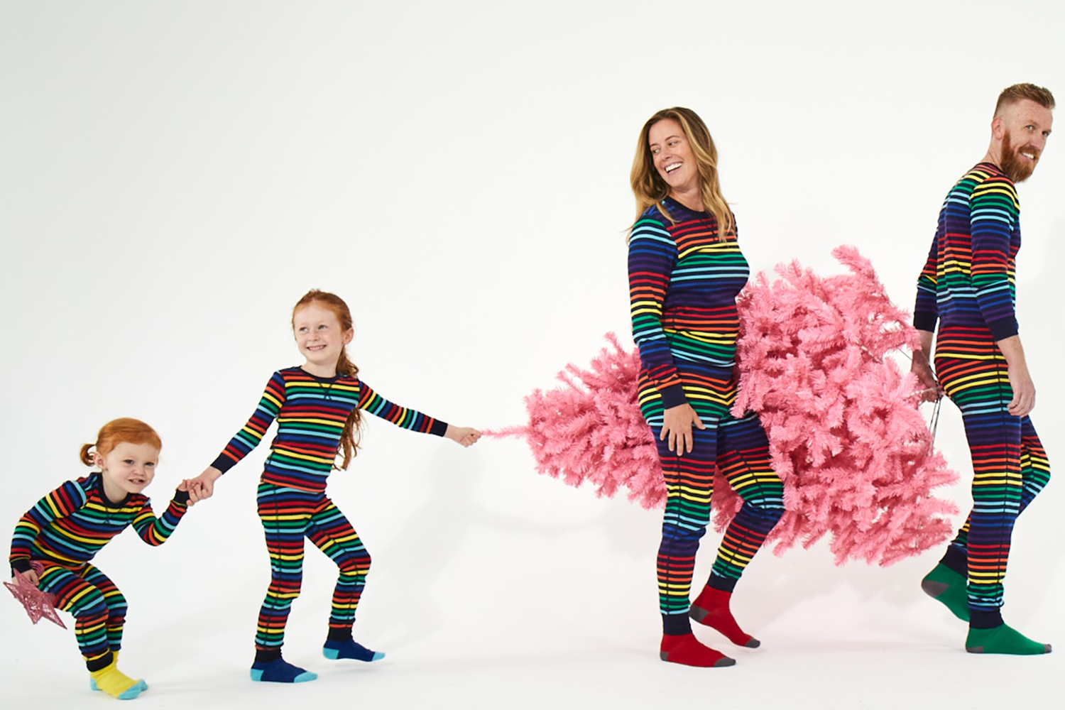 Primary navy rainbow matching family PJs