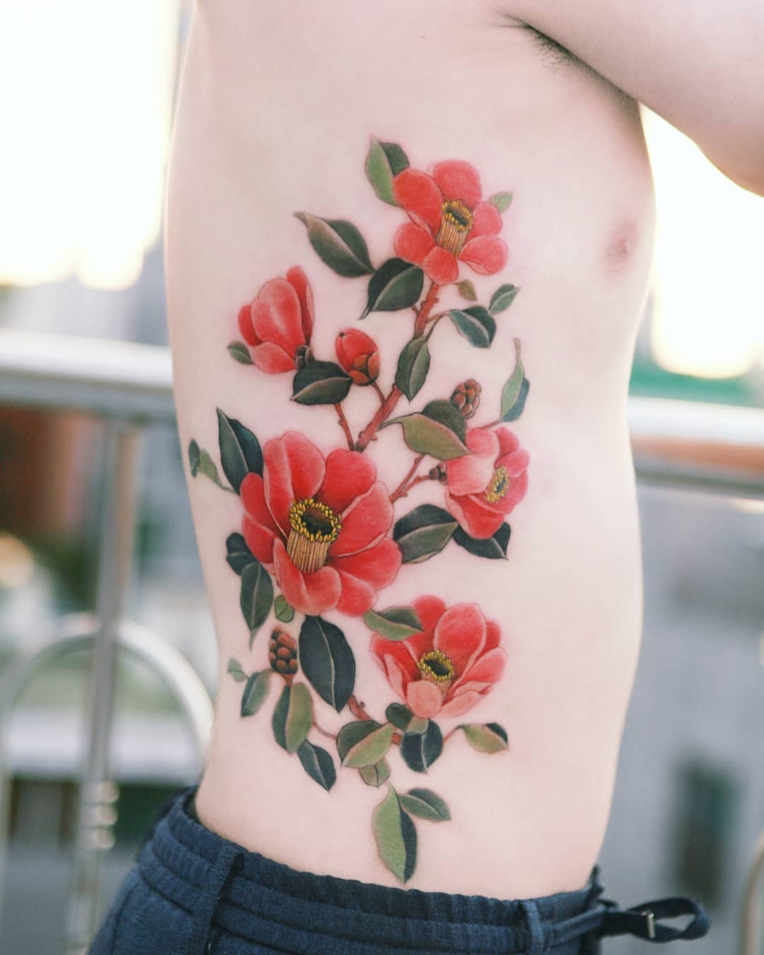 camellia red blooming flower tattoo