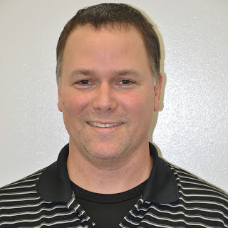 Swimming coach Dean Hutchinson of Strive Physical Therapy and Aquatic Rehabilitation