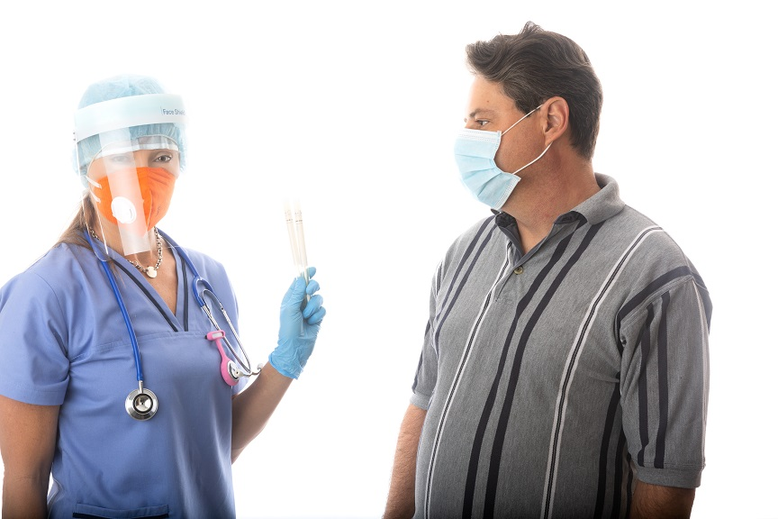 Doctor wearing face shield tests patient for COVID-19 - Coronavirus
