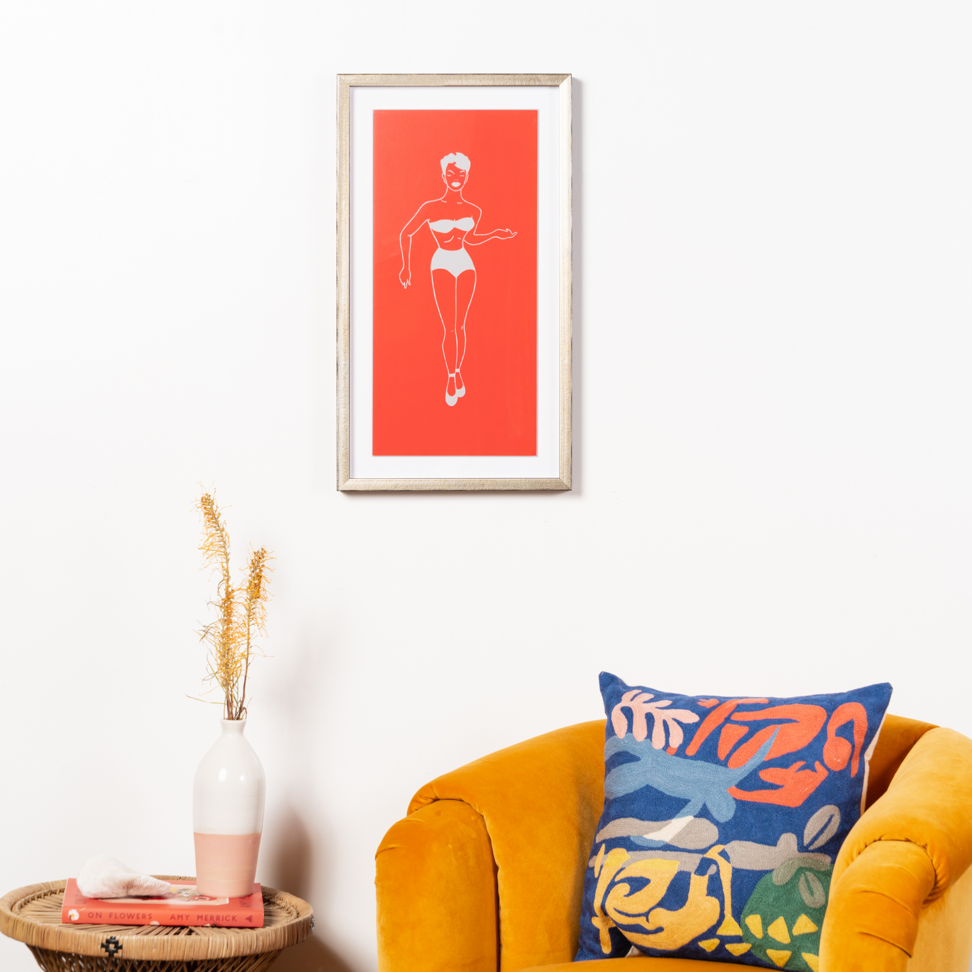 silhouette with oranfge background in silver frame