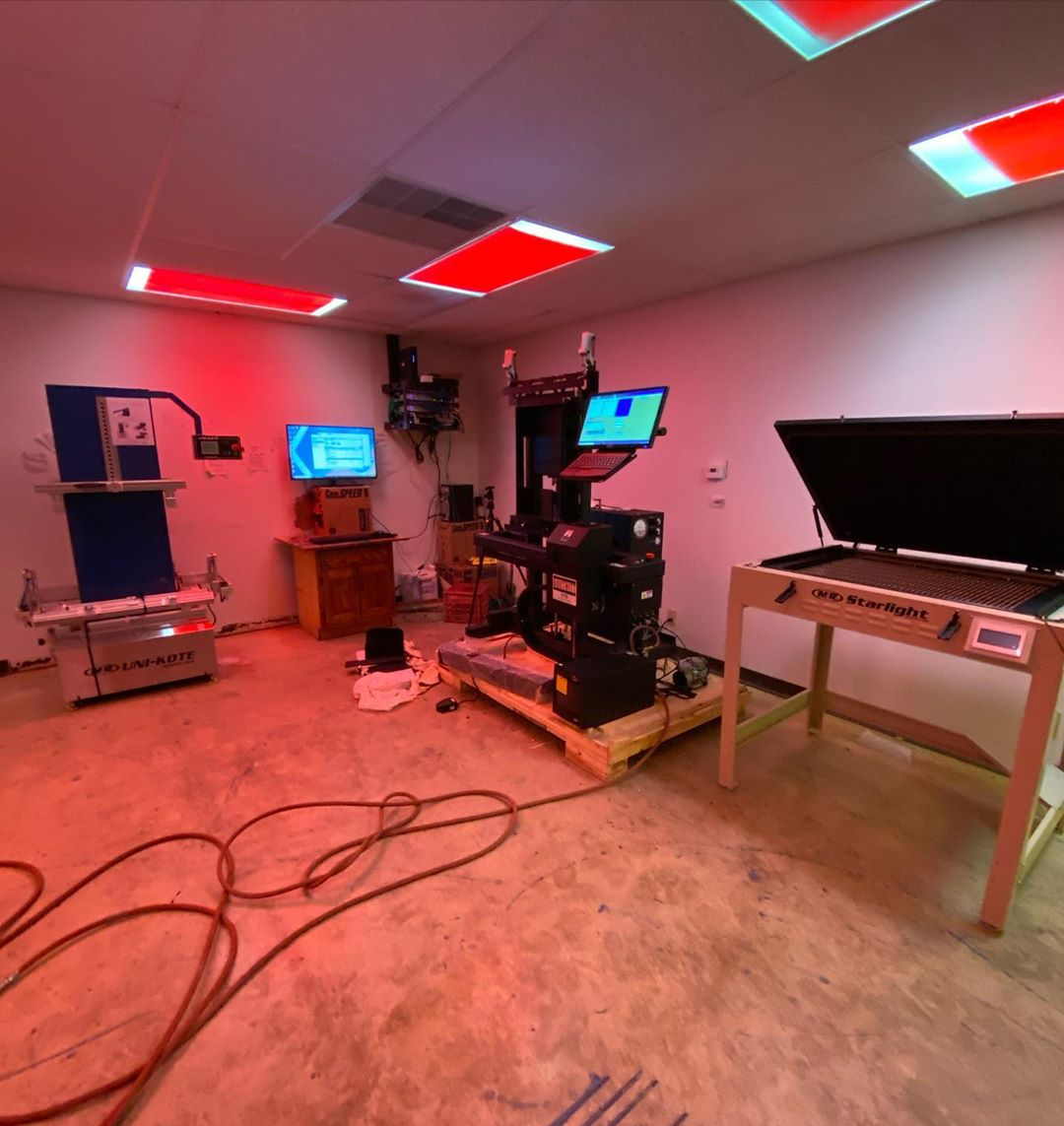 An advanced screen printing screen room with a M&R UniKote, M&R Starlight, and Douthitt CTS machine.