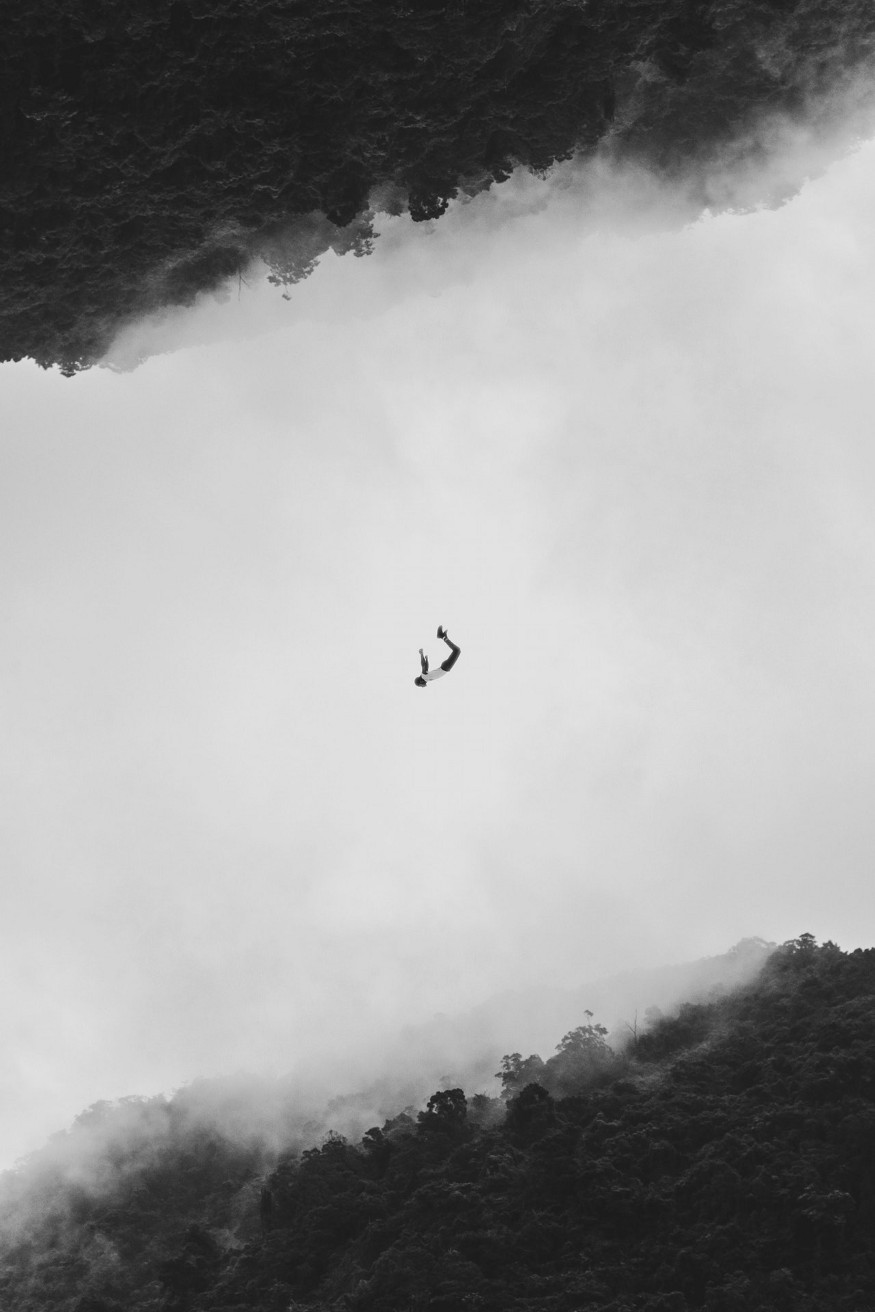 man falling down surrownded by clouds