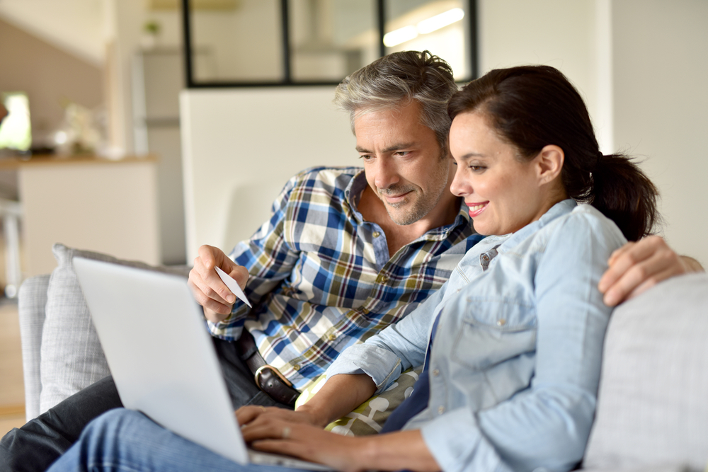couple checking laptop