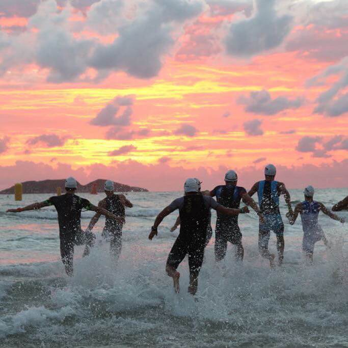 triathletes at swim start at the inaugural IRONMAN 70.3 Florianópolis