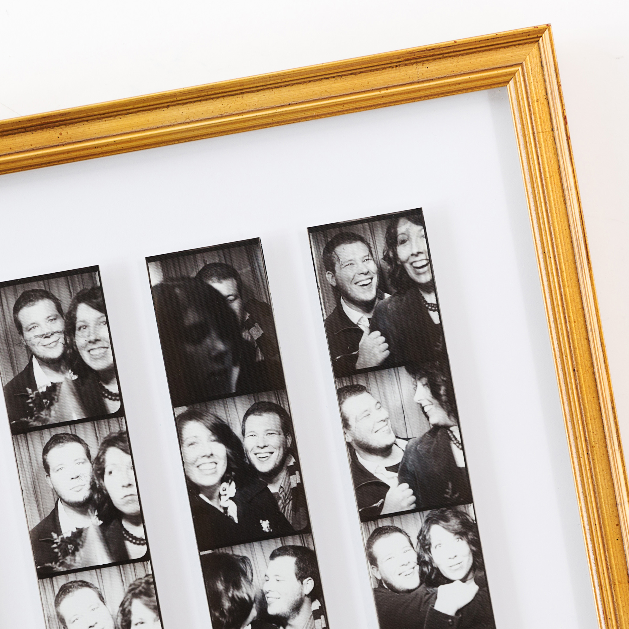 Black & White photo strips framed in thin gold richmond frame