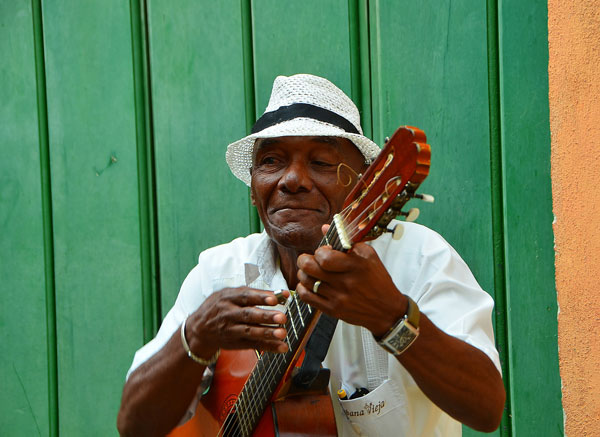 local man in cuba playing guitar