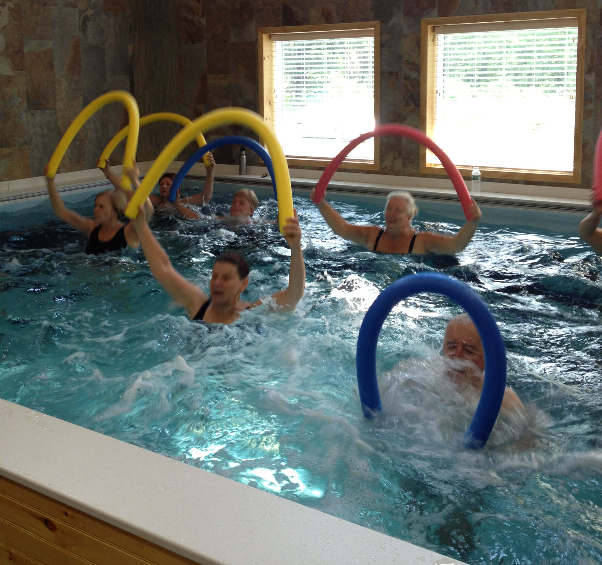 an aquatic aerobics class in the Endless Pool at Pike Physical Therapy