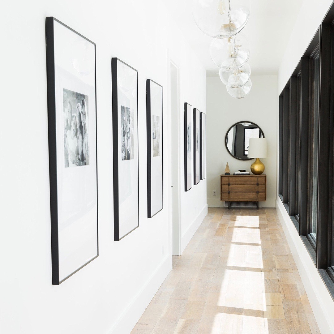 hallway with windows and six black frames