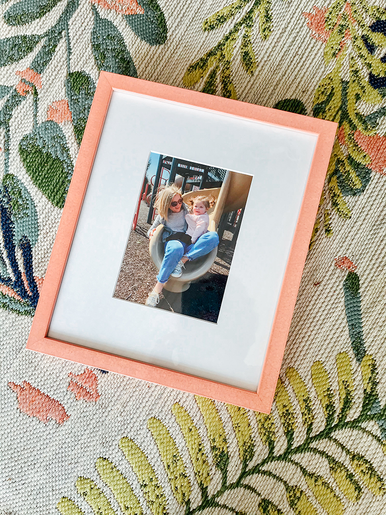 photo of pink frame with woman and child on slide