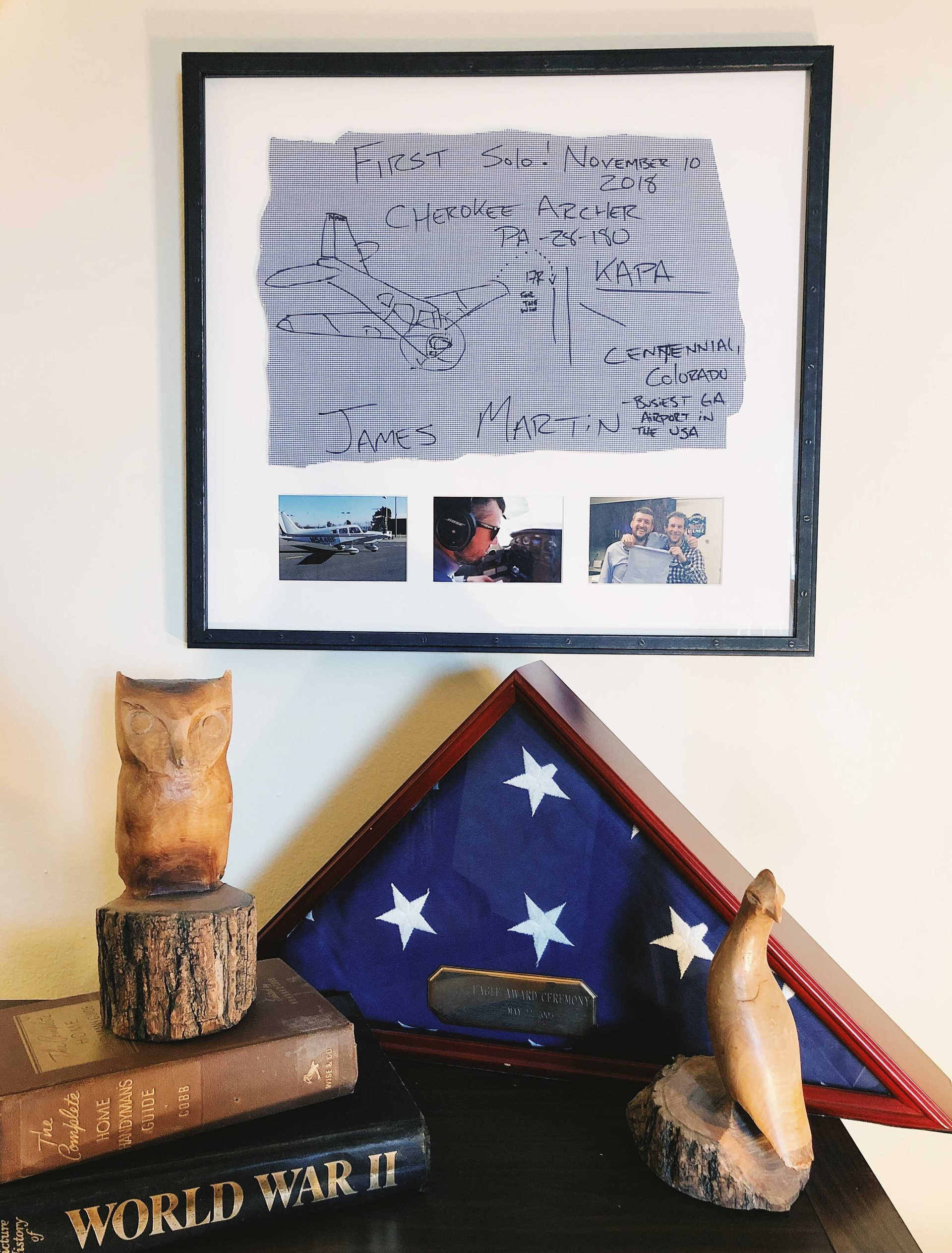 framed shirttail on shelf with flag