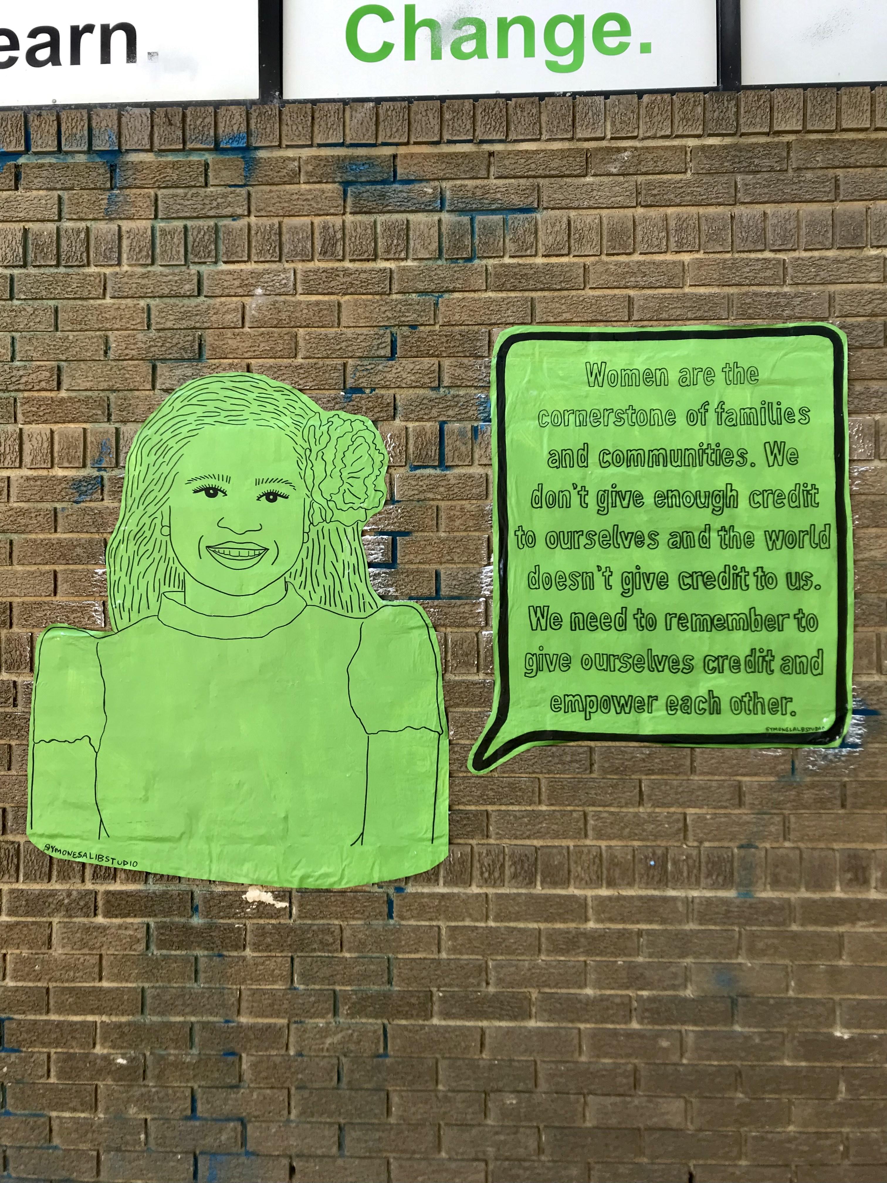 art portrait on brick wall