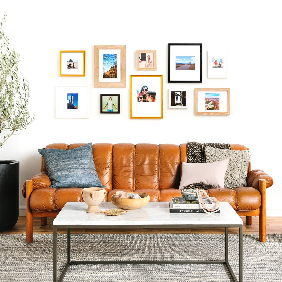 wide organic gallery wall in eclectic frames