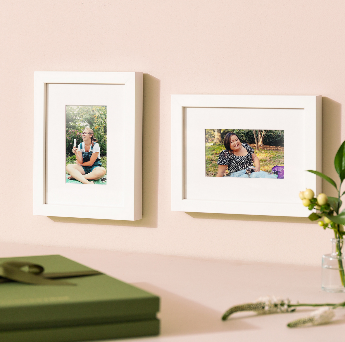 two white frames with photos of friends