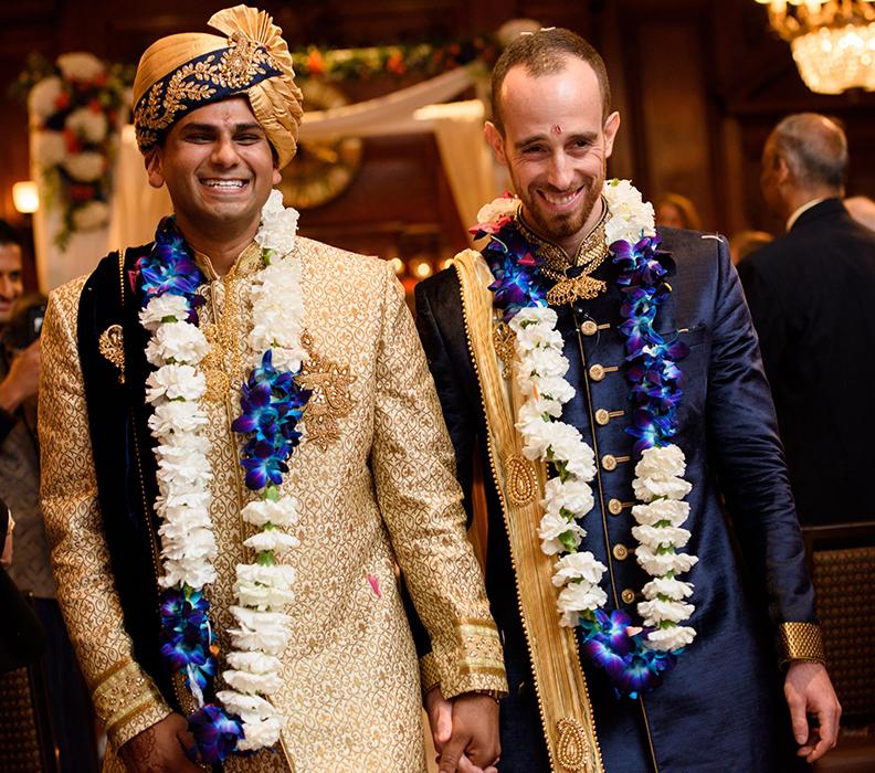 wedding photo of two men walking down aisle
