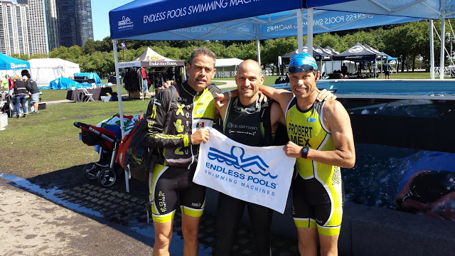 3 age-group triathletes at the Endless Pools swimming machine at ITU World Triathlon Grand Final Chicago