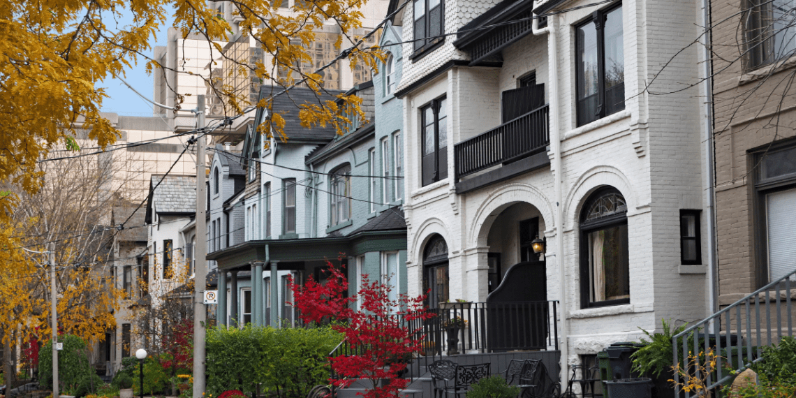 multistory linked homes on a leafy street