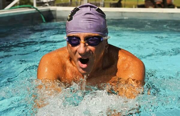 Swim coach Ray Scharf swimming in his Endless Pool