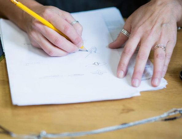 Lisa sketching a jewelry design