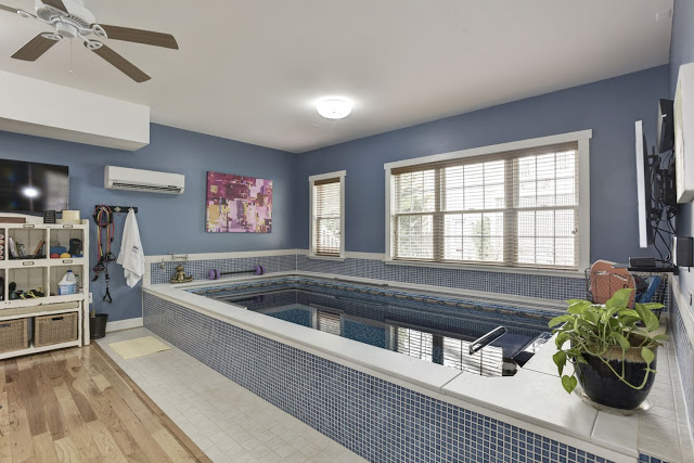 A partially in-ground Endless Pool in a converted garage