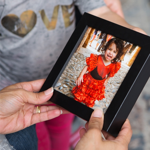 baby in red dress in picture frame