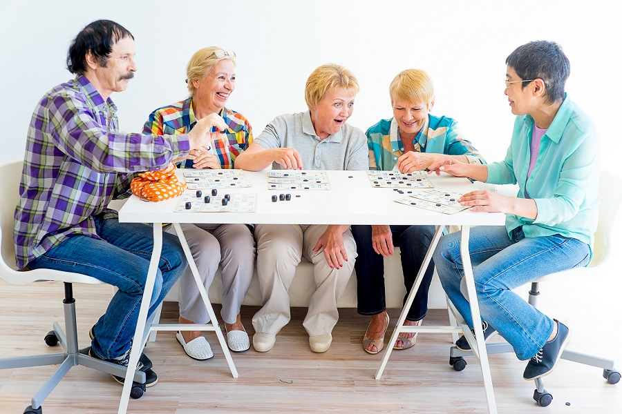 senior citizens playing bingo-an activity in your area as seen at The National Institute on Aging and National Council on Aging
