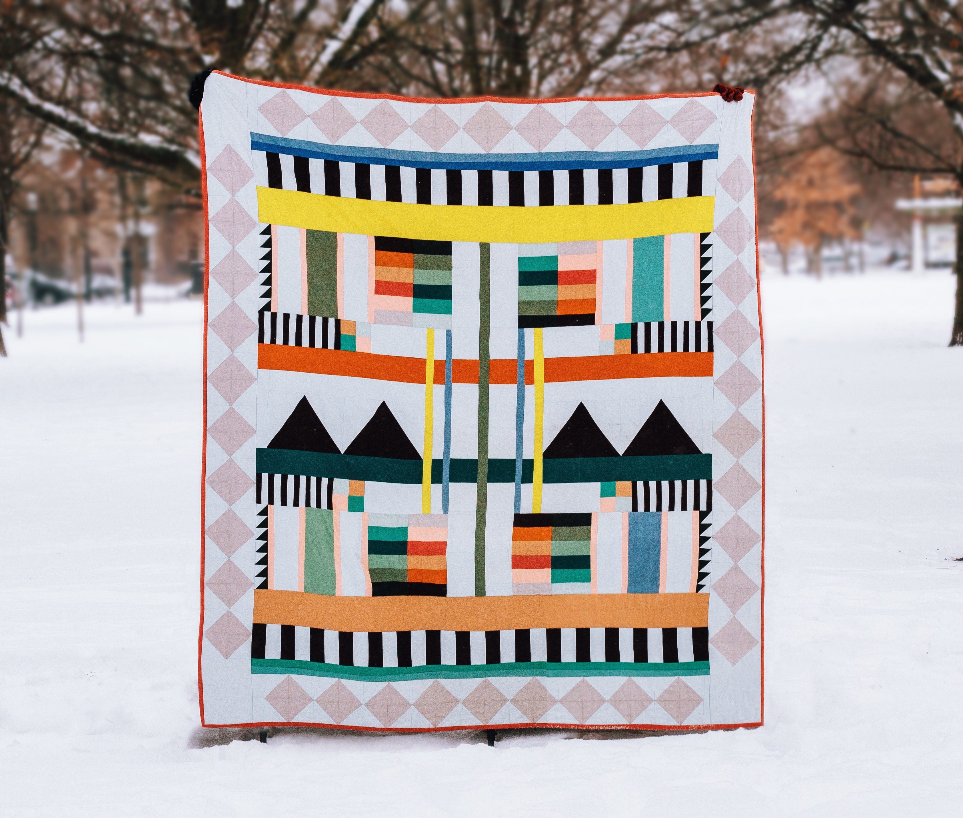 woman holding quilt in snow
