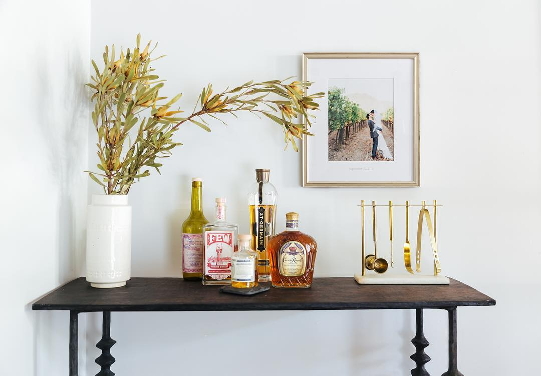 A framed photo of husband and wife over a bar table