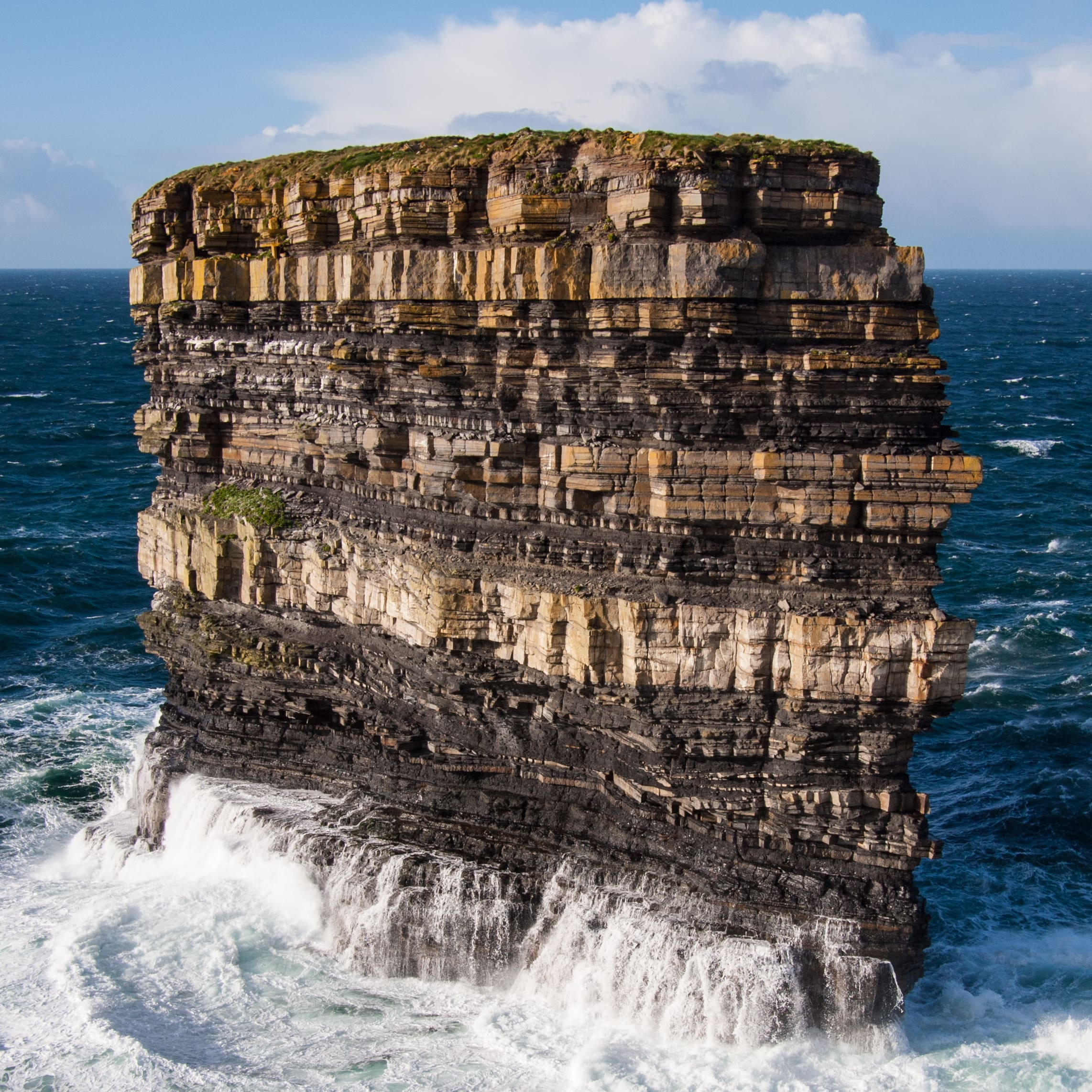 Visiting the awesome Irish Sea Stacks is a cool thing to do in Ireland
