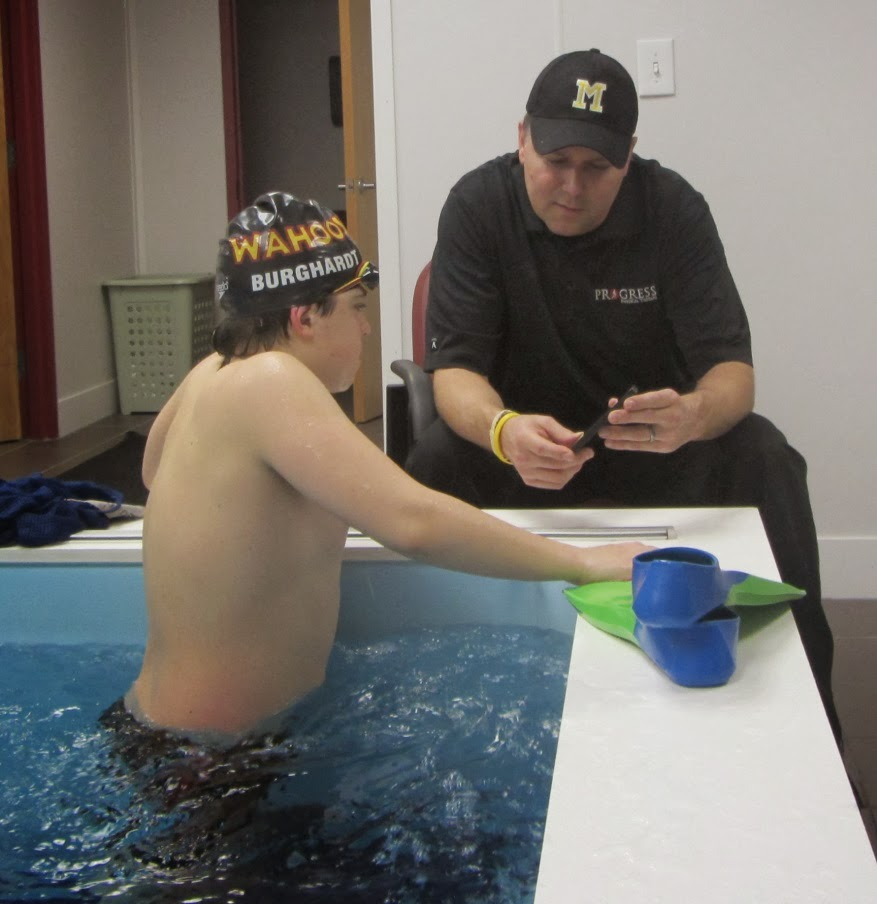 Coach Hutchinson discussing swim technique with a Jersey Wahoo swimmer