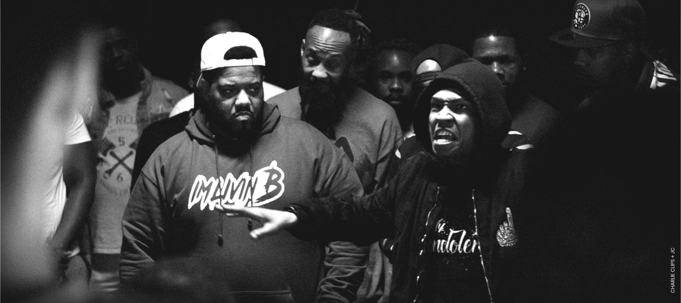 Charlie Clips and JC from Ultimate Rap League (URL) in the middle of a rap battle