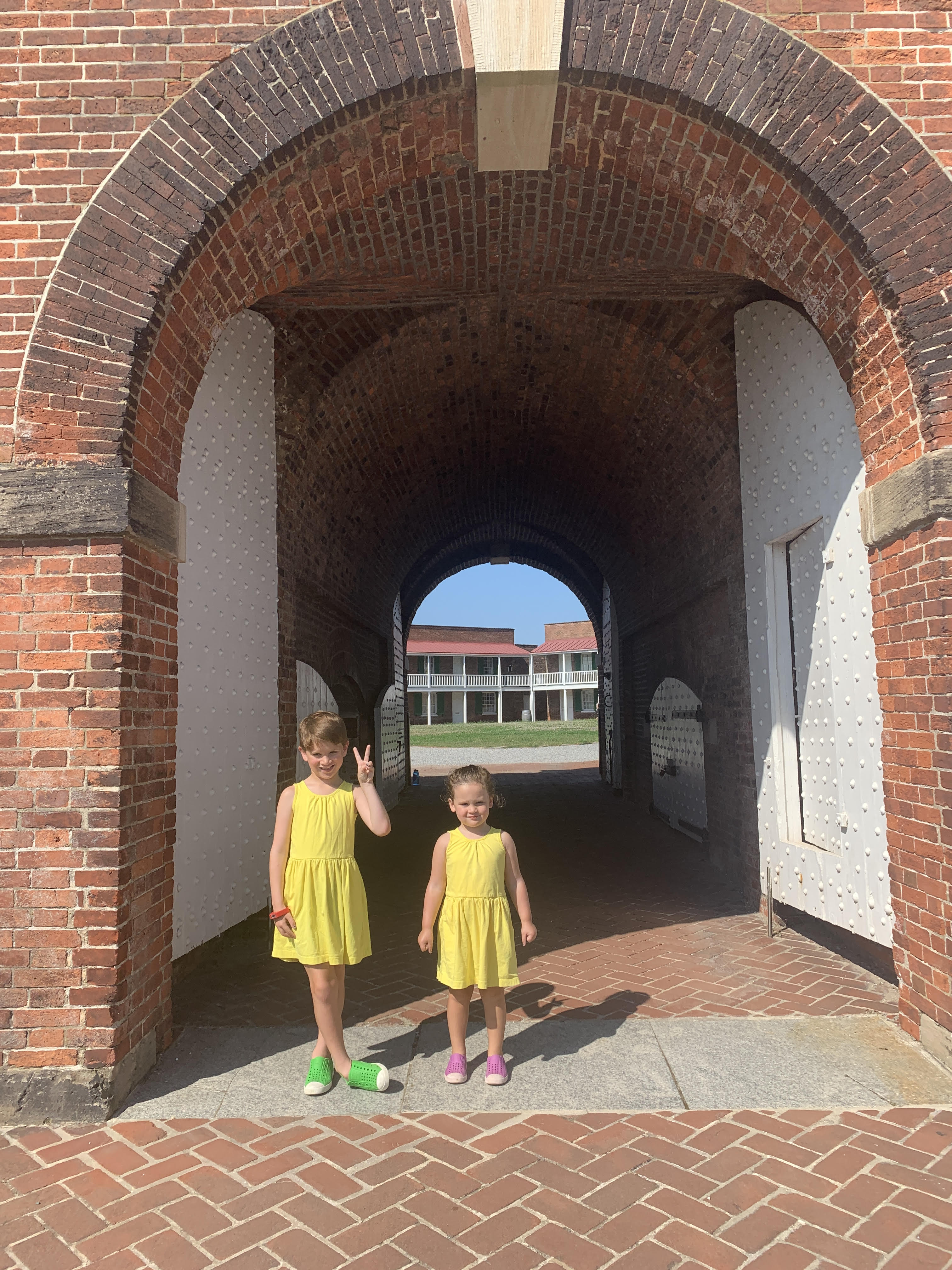 little boy and girl in matching sleeveless sunshine yellow dresses from primary