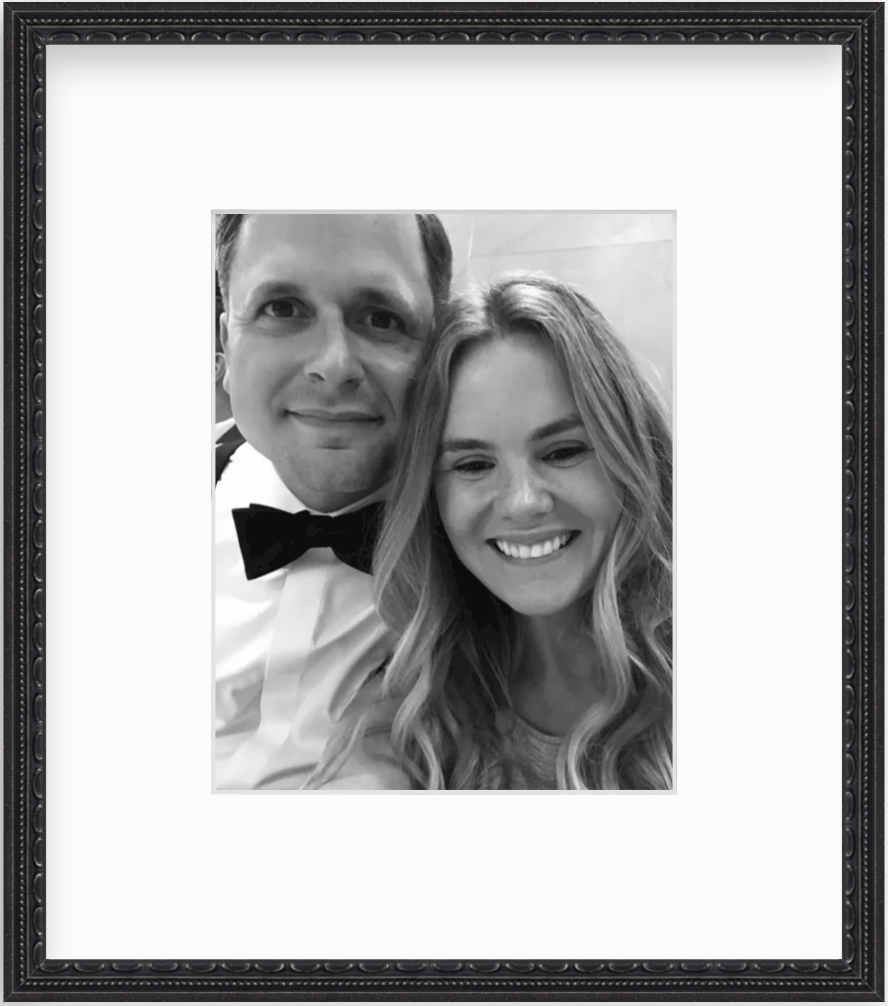 framed black and white photo of couple smiling