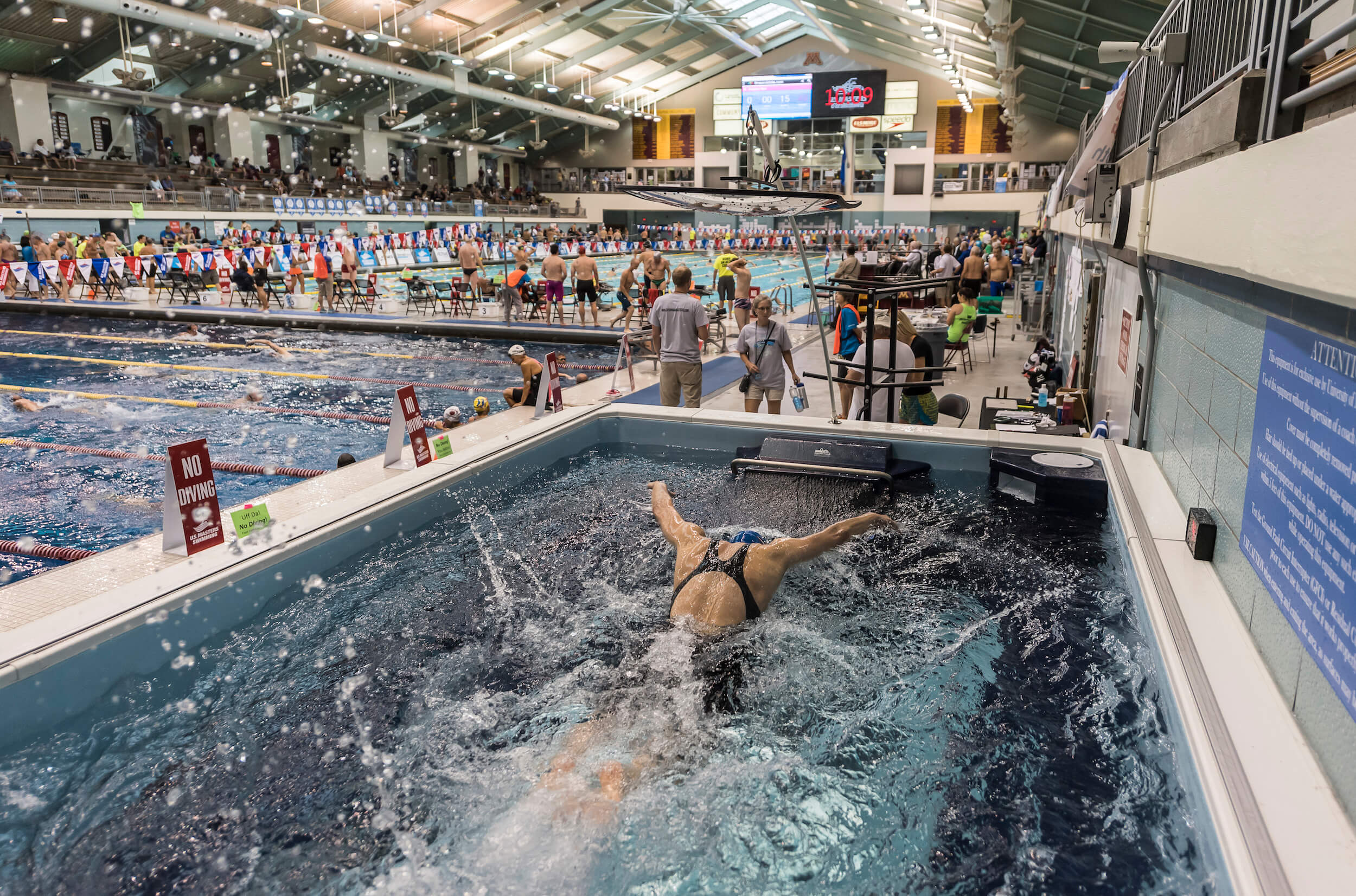 A swimmer doing butterfly stroke in the Elite Endless Pool at the 2017 US Masters Swimming Summer Nationals