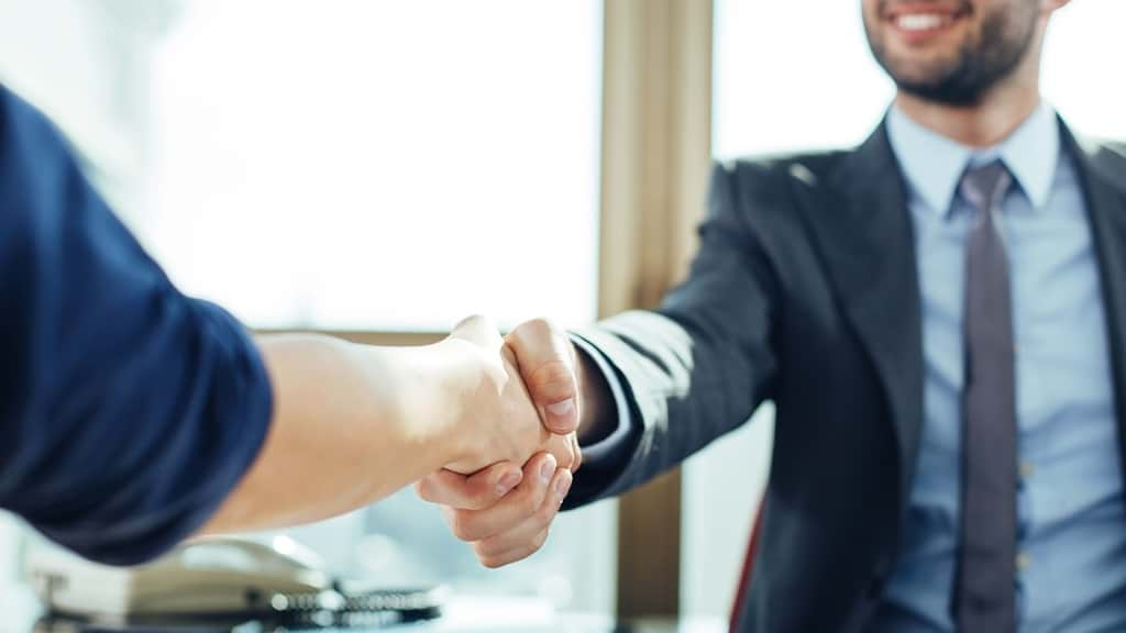 Closing a Deal with a Handshake Image. Opens contact form