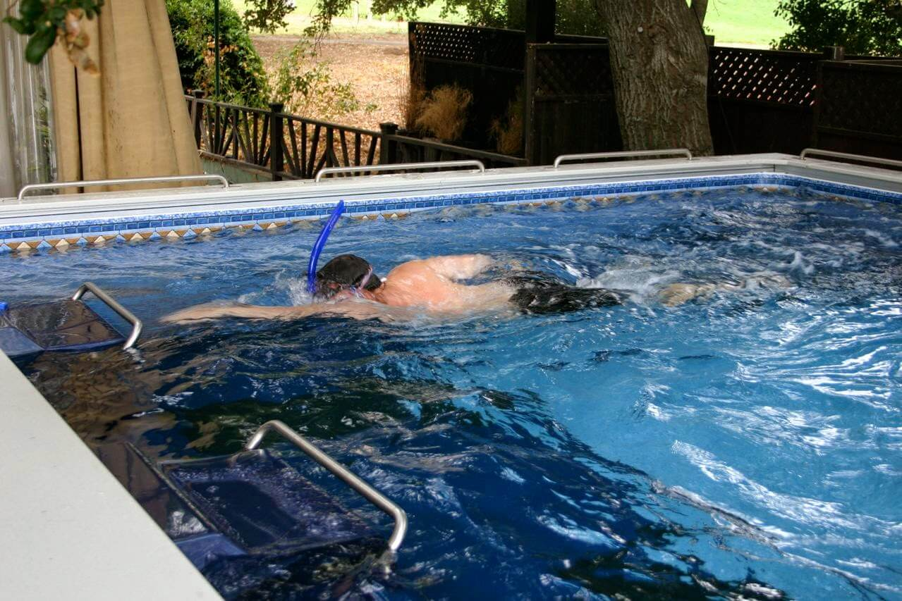 A contestant on The Biggest Loser swims in the Dual Propulsion Endless Pool
