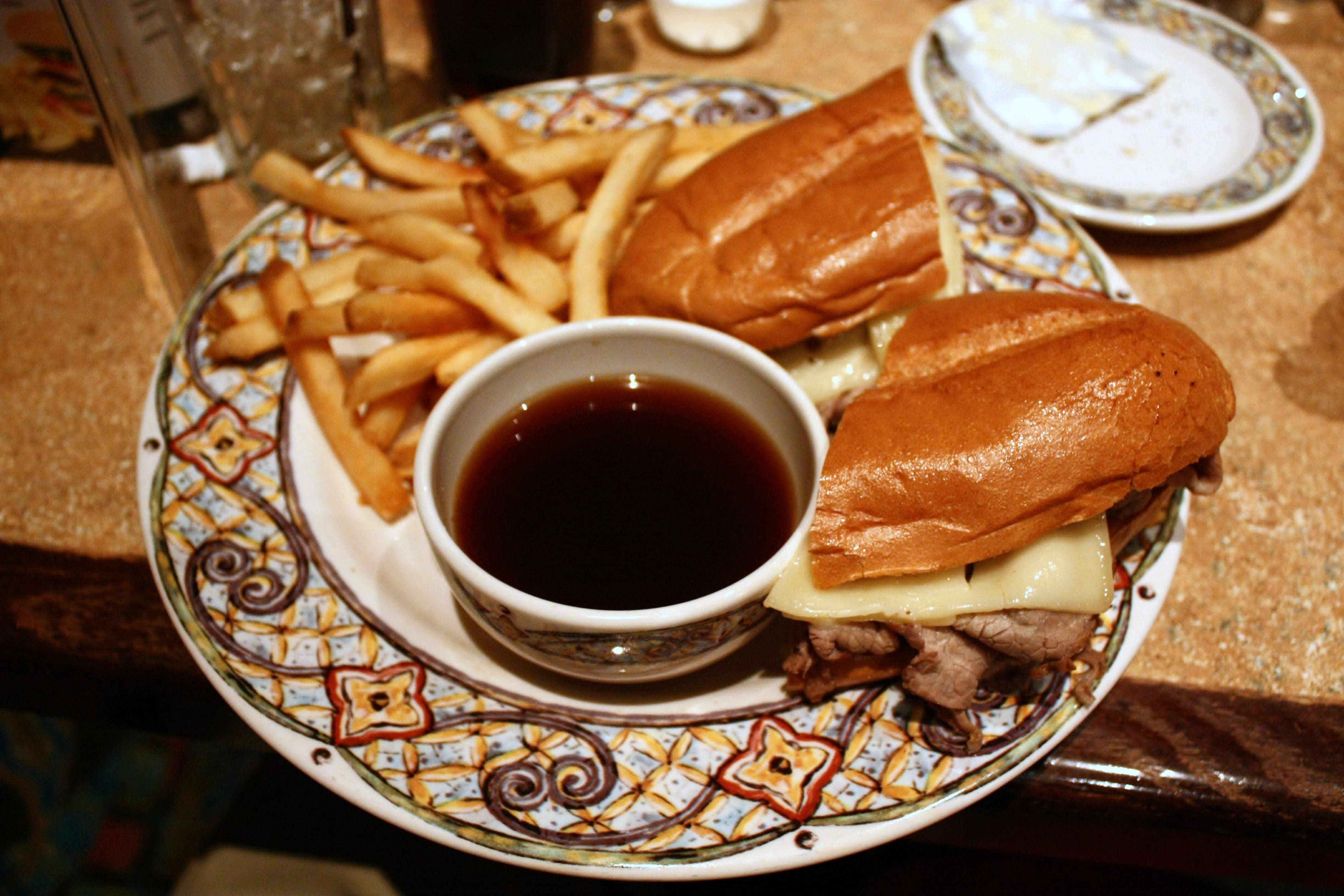 A delicious place to visit in LA is Cole's, or Philippe's, both of whom claim to have invented the French dip