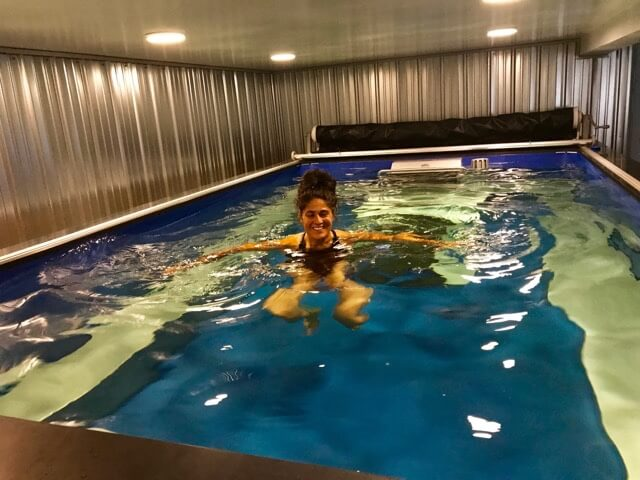 Former runner Shawn in the Performance Endless Pool in the basement of her Vermont farmhouse